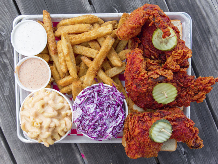 Plate of chicken, coleslaw, and fries